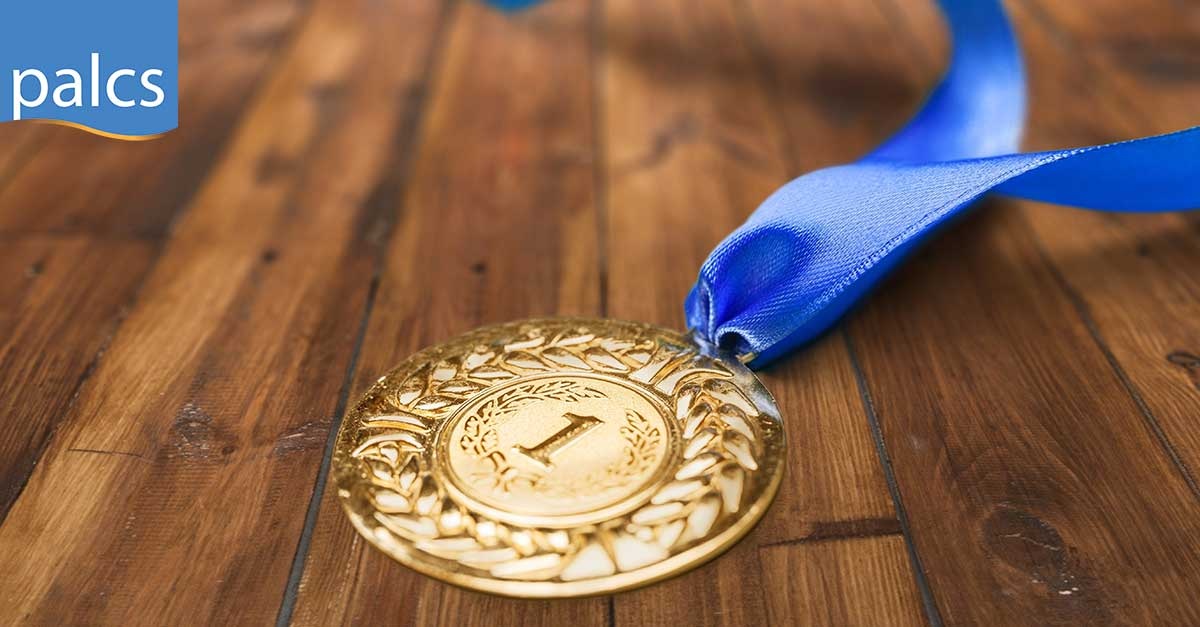 Number 1 gold medal with blue ribbon