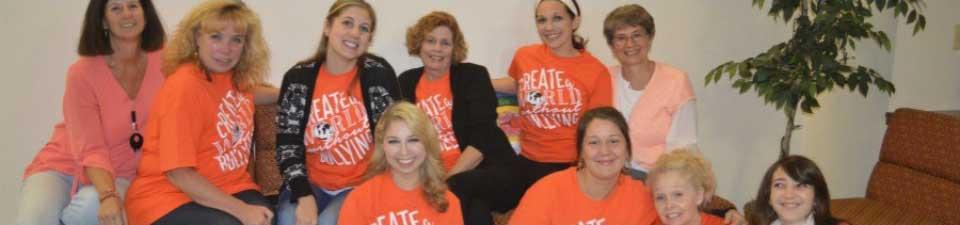palcs staff wearing orange shirts saying create a world without bullying