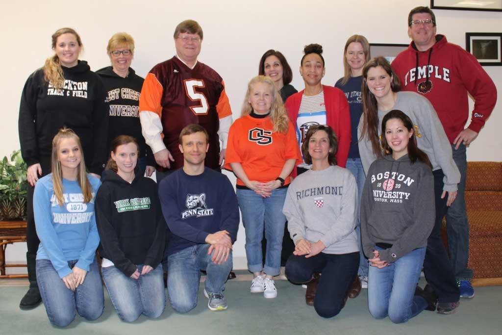 palcs faculty and staff wearing shirts from their colleges