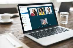 Images of people on a laptop screen