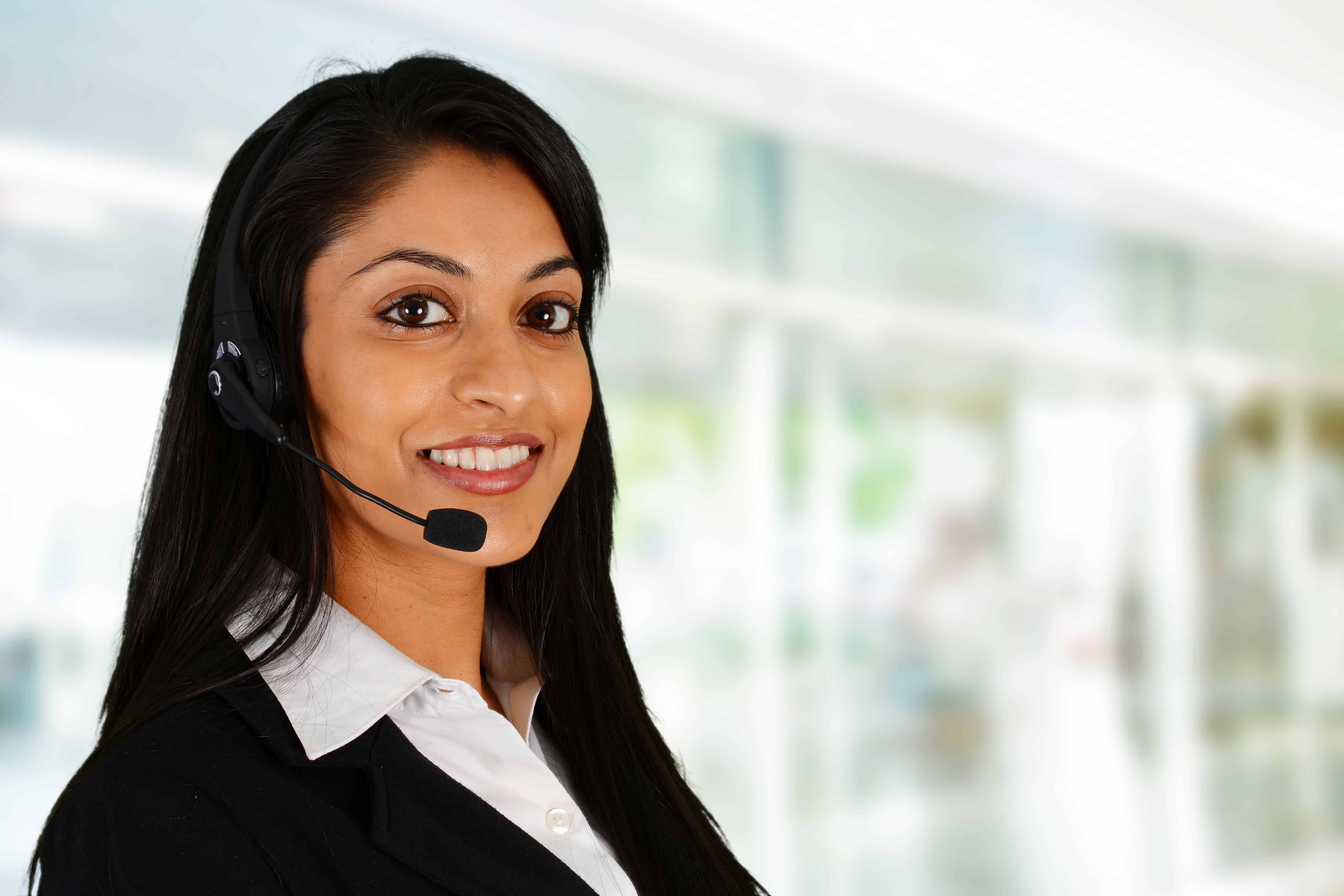 Woman with headset conducting online information session