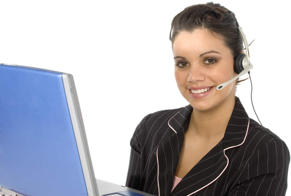 Woman with headset on computer conducting online information session