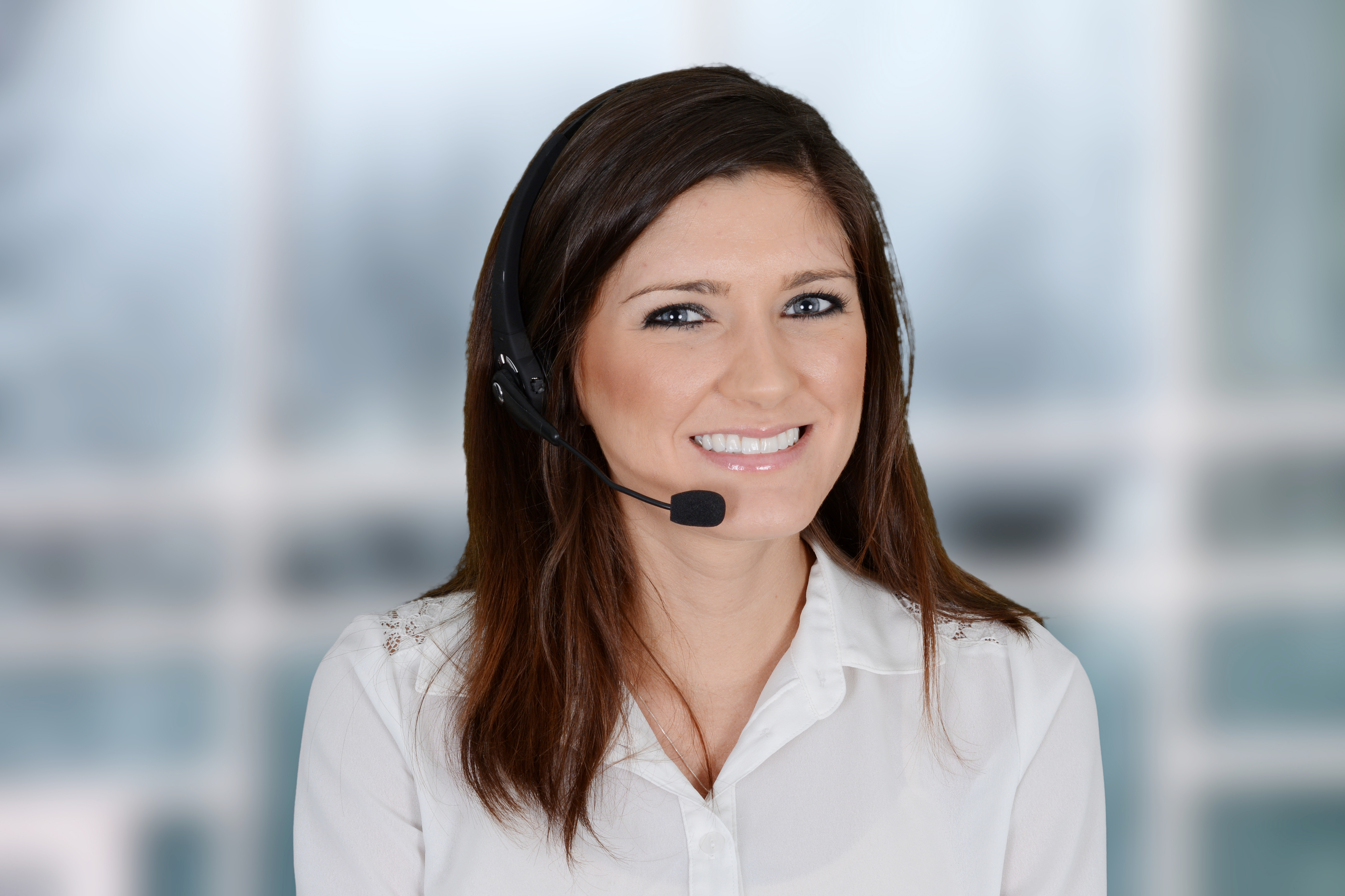 Woman with headset preparing for online meeting